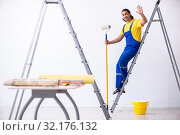 Купить «Young man contractor doing renovation at home», фото № 32176132, снято 4 июня 2019 г. (c) Elnur / Фотобанк Лори