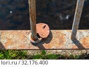 Купить «Замок на пешеходном мосту через Пскову. Псков», эксклюзивное фото № 32176400, снято 1 сентября 2019 г. (c) Александр Щепин / Фотобанк Лори