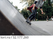 Купить «Roller skating, young skater rolling off the ramp», фото № 32177260, снято 5 июня 2019 г. (c) Tryapitsyn Sergiy / Фотобанк Лори