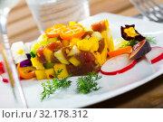 Купить «Raw tuna tartare with mango and avocado», фото № 32178312, снято 16 сентября 2019 г. (c) Яков Филимонов / Фотобанк Лори