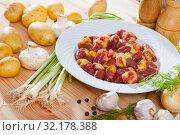 Купить «Raw chicken hearts with fresh vegetables», фото № 32178388, снято 16 сентября 2019 г. (c) Яков Филимонов / Фотобанк Лори