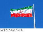 Купить «Flag of Iran waving in the wind against the sky», фото № 32178848, снято 17 июня 2018 г. (c) FotograFF / Фотобанк Лори