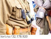 Купить «Vintage leather holster, binoculars and other ammunition on the belt», фото № 32178920, снято 6 октября 2018 г. (c) FotograFF / Фотобанк Лори