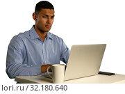 Купить «Young businessman using a laptop», фото № 32180640, снято 24 октября 2018 г. (c) Wavebreak Media / Фотобанк Лори