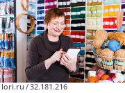 Купить «Woman with needlework accessories and talking on phone», фото № 32181216, снято 10 мая 2017 г. (c) Яков Филимонов / Фотобанк Лори
