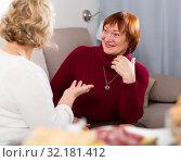Smiling mature lady with female friend at home. Стоковое фото, фотограф Яков Филимонов / Фотобанк Лори