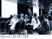 Купить «Audience in the lecture hall attending scientific business conference.», фото № 32181724, снято 2 декабря 2016 г. (c) Matej Kastelic / Фотобанк Лори