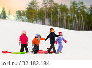Купить «happy little kids with sleds in winter», фото № 32182184, снято 10 февраля 2018 г. (c) Syda Productions / Фотобанк Лори