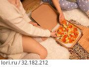 Купить «happy female friends eating pizza at home», фото № 32182212, снято 21 января 2018 г. (c) Syda Productions / Фотобанк Лори