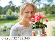 Купить «young woman with cyclamen flowers at summer garden», фото № 32182340, снято 12 июля 2019 г. (c) Syda Productions / Фотобанк Лори