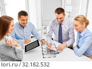 Купить «happy business team discussing blueprint at office», фото № 32182532, снято 5 апреля 2014 г. (c) Syda Productions / Фотобанк Лори
