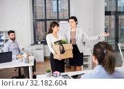 Купить «executive seeing off fired female office worker», фото № 32182604, снято 23 марта 2019 г. (c) Syda Productions / Фотобанк Лори