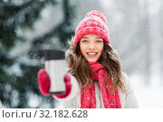 Купить «young woman with hot drink in tumbler in winter», фото № 32182628, снято 29 января 2019 г. (c) Syda Productions / Фотобанк Лори
