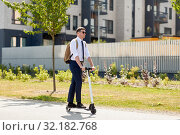 Купить «businessman with backpack riding electric scooter», фото № 32182768, снято 1 августа 2019 г. (c) Syda Productions / Фотобанк Лори