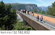 Купить «Spectacular Stegastein viewing platform above Aurlandsfjord. It is located on national tourist route Aurlandsfjellet. It is build with front class wall. Norway», видеоролик № 32182832, снято 6 июня 2019 г. (c) Кекяляйнен Андрей / Фотобанк Лори