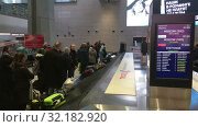 Купить «Terminal 1 interior and baggage area after renovation. Arriving area. Pulkovo is one of the largest airports in Russia and Eastern Europe», видеоролик № 32182920, снято 2 апреля 2019 г. (c) Кекяляйнен Андрей / Фотобанк Лори