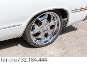 Купить «Automotive wheel on light alloy disc with low profile tire», фото № 32184444, снято 18 мая 2019 г. (c) FotograFF / Фотобанк Лори