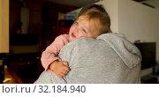 Купить «Father hugging adorable little kid», видеоролик № 32184940, снято 13 сентября 2019 г. (c) Ekaterina Demidova / Фотобанк Лори