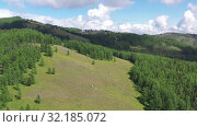 Купить «Aerial video view from drone on Altai natural landscape of Ulagan Plateau. Altai, Siberia, Russia», видеоролик № 32185072, снято 24 августа 2019 г. (c) Serg Zastavkin / Фотобанк Лори