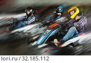Купить «Man and women competing on racing cars», фото № 32185112, снято 18 марта 2019 г. (c) Яков Филимонов / Фотобанк Лори