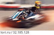 Купить «Girl driving kart at racing track outdoors», фото № 32185128, снято 18 марта 2019 г. (c) Яков Филимонов / Фотобанк Лори