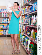 Купить «Charming female want to buying softener in bottle», фото № 32185280, снято 6 июня 2017 г. (c) Яков Филимонов / Фотобанк Лори