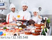 Купить «chefs offering fresh marine products for tasting», фото № 32185548, снято 26 января 2018 г. (c) Яков Филимонов / Фотобанк Лори