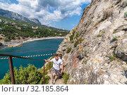 Купить «Simeiz, Crimea - July 1, 2019.View of the city of Simeiz from the cliff of Diva.», фото № 32185864, снято 1 июля 2019 г. (c) Володина Ольга / Фотобанк Лори