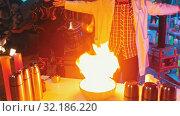 Купить «A man lighting up a substance in the bowl and setting it on fire», видеоролик № 32186220, снято 25 февраля 2020 г. (c) Константин Шишкин / Фотобанк Лори