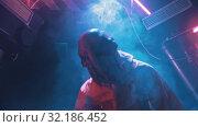 Купить «An alien with tentacles in the lower face walking on the secret laboratory in worker clothes», видеоролик № 32186452, снято 20 октября 2019 г. (c) Константин Шишкин / Фотобанк Лори