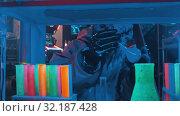 Купить «An alien with tentacles in the lower face looking around in the secret lab and touching the flasks», видеоролик № 32187428, снято 20 октября 2019 г. (c) Константин Шишкин / Фотобанк Лори