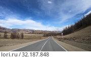 Купить «Driving along mountain road Chuysky Tract along Kurai Ridge on Altai at Spring season», видеоролик № 32187848, снято 16 июля 2019 г. (c) Serg Zastavkin / Фотобанк Лори