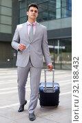 Купить «Businessman walking with travel bag», фото № 32188432, снято 8 мая 2017 г. (c) Яков Филимонов / Фотобанк Лори
