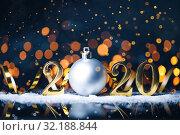 Купить «Christmas year from golden numbers with gold sparkle bokeh on dark blue background.», фото № 32188844, снято 30 августа 2019 г. (c) Евдокимов Максим / Фотобанк Лори