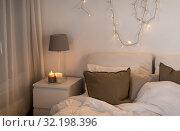 Купить «sofa with cushions at cozy home living room», фото № 32198396, снято 15 октября 2016 г. (c) Syda Productions / Фотобанк Лори