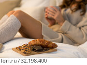 Купить «sweets and woman with cup of coffee in bed at home», фото № 32198400, снято 15 октября 2016 г. (c) Syda Productions / Фотобанк Лори