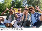 Купить «happy friends making faces at summer park», фото № 32198656, снято 15 июня 2019 г. (c) Syda Productions / Фотобанк Лори