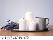 Купить «candles, tea in mug and lavender flowers on table», фото № 32198676, снято 12 апреля 2019 г. (c) Syda Productions / Фотобанк Лори