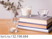 Купить «fragrance candles burning and books on table», фото № 32198684, снято 12 апреля 2019 г. (c) Syda Productions / Фотобанк Лори