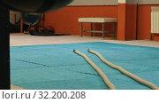 Купить «An interior of the gym - the ropes lying on the floor», видеоролик № 32200208, снято 22 сентября 2019 г. (c) Константин Шишкин / Фотобанк Лори