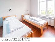 Twin bed room in hotel. Стоковое фото, фотограф Elnur / Фотобанк Лори