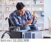 Купить «Computer repairman on wheelchair working», фото № 32202908, снято 20 апреля 2017 г. (c) Elnur / Фотобанк Лори