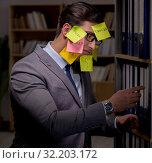 Купить «Businessman struggling with conflicting priorities during long h», фото № 32203172, снято 25 января 2017 г. (c) Elnur / Фотобанк Лори