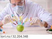 Купить «Male nutrition expert testing food products in lab», фото № 32204348, снято 19 апреля 2019 г. (c) Elnur / Фотобанк Лори