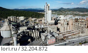 Купить «View from drone of cement plant industrial area, Catalonia, Spain», видеоролик № 32204872, снято 25 декабря 2018 г. (c) Яков Филимонов / Фотобанк Лори