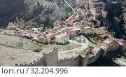 Купить «Defensive Northern wall of Albarracin on background of cityscape with Cathedral tower, Aragon, Spain», видеоролик № 32204996, снято 26 декабря 2018 г. (c) Яков Филимонов / Фотобанк Лори