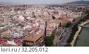 Купить «Aerial panoramic view of Murcia cityscape with bell tower of Cathedral Church of Saint Mary, Spain», видеоролик № 32205012, снято 17 апреля 2019 г. (c) Яков Филимонов / Фотобанк Лори