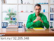Купить «Chemistry student studying for exams», фото № 32205348, снято 27 июня 2019 г. (c) Elnur / Фотобанк Лори