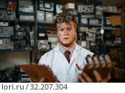 Купить «Strange engineer looks on electronic chips in lab», фото № 32207304, снято 17 июня 2019 г. (c) Tryapitsyn Sergiy / Фотобанк Лори