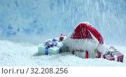 Купить «Santa hat and gifts in snow», видеоролик № 32208256, снято 22 сентября 2019 г. (c) Иван Михайлов / Фотобанк Лори